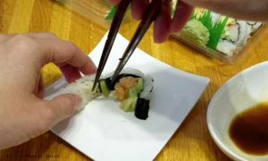 separate the piece of fish from the maki sushi