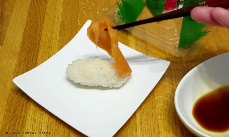 separate the piece of fish from the nigiri sushi